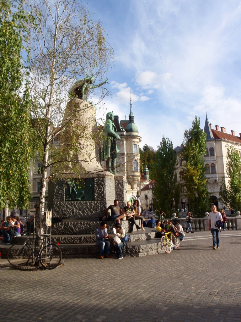 Downtown Ljubljana, where the well known statue of Joze Plecnik (with his muse above) catches the autumn evening light.