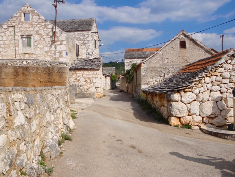 Quiet streets and the ubiquitous white stones in one of many small villages we passed.