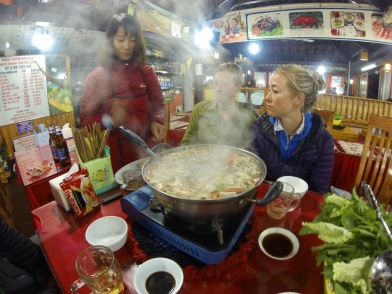 Getting some help from the friendly locals, since we had no idea how hot pot actually worked :)