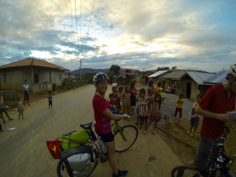 Surrounded by curious munchkins in a traditional village. There are 29 ethnic groups in the area.