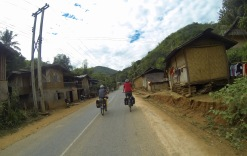 Riding through one of many impoverished but fascinating minority Tai villages.