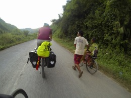 Getting caught in the evening commute of villagers coming back from fields on foot and on bikes.