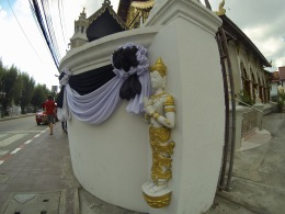 A nearby Wat, still strung with the colors of mourning for the late Thai president.