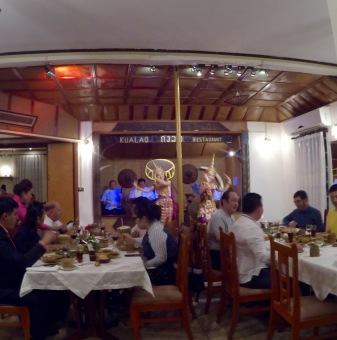 Traditional Laotian dancing and the first white tablecloths we've eaten upon the whole trip.