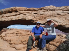 The parental units at a windy Mesa Arch.