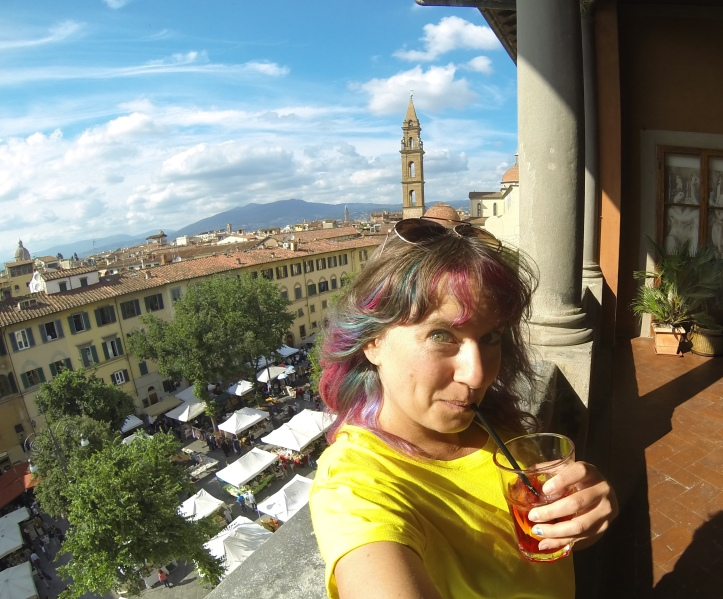 Woman drinking a spritz in Florence, Italy.