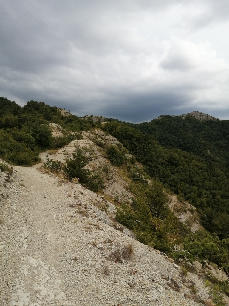 Dark, brooding skies and trail through calanchi