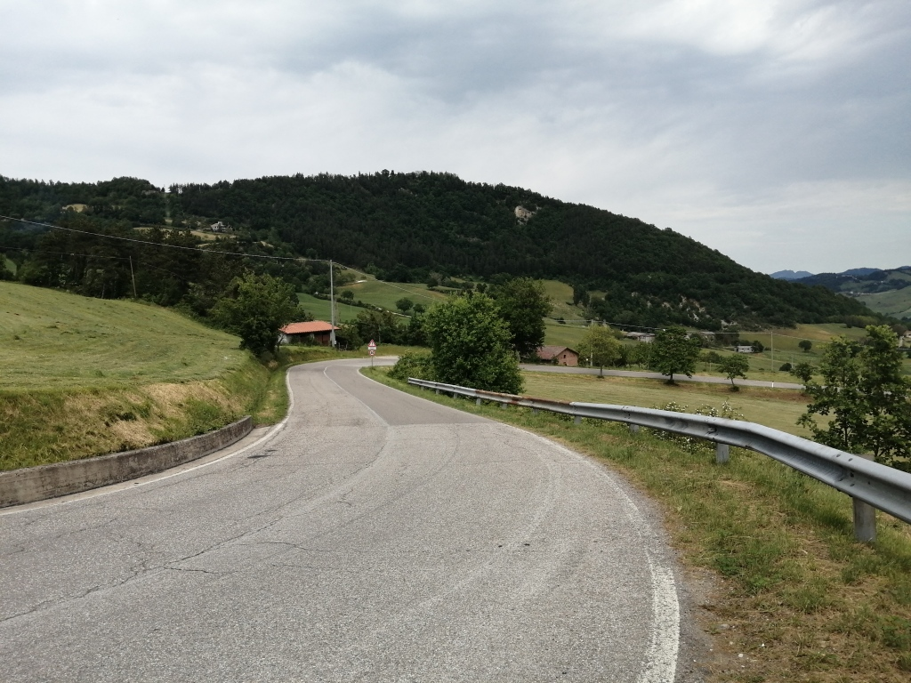 Descending on a smooth paved road from Passo del Carnaio.