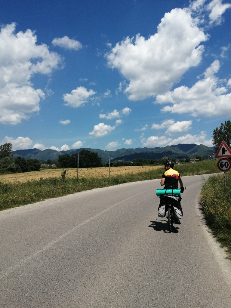 Bike tourist in Tuscany on a sunny day.